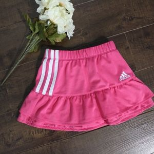 Adidas pink athletic skirt with shorts and stripes